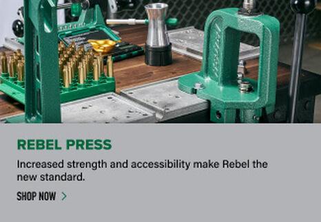 Rebel Press displayed on reloading bench