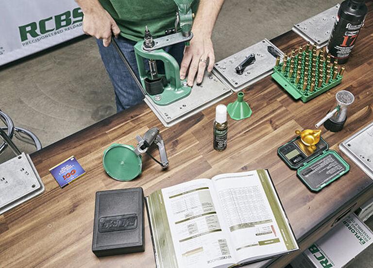 Reloader using RCBS Rebel Master Reloading Kit on bench